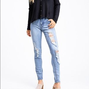 Light Blue Denim Distressed Mid Rise Skinny Jeans